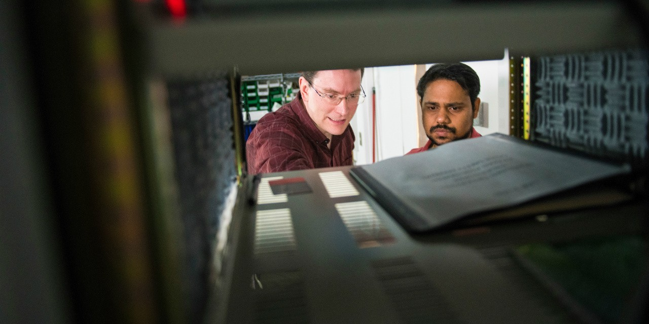 Biophysicist Michael Woodside (left) and post-doctoral fellow Supratik Sen Mojumdar in Woodside's lab in the Centennial Centre for Interdisciplinary Science (Photo: John Ulan)