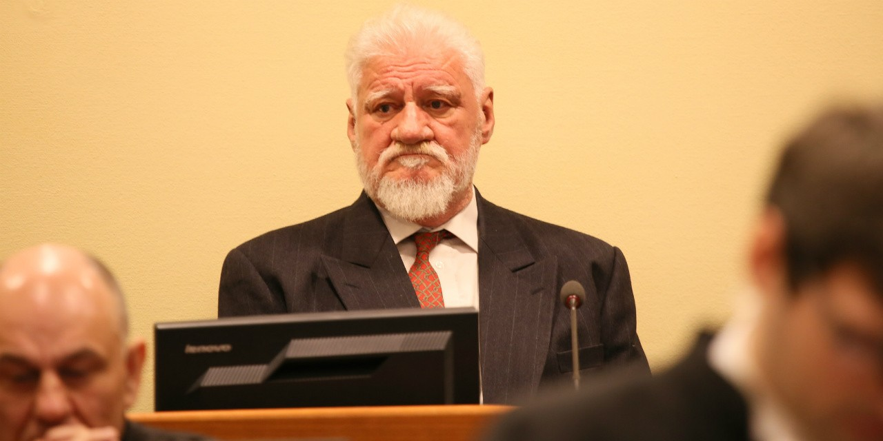 General Slobodan Praljak appears before the International Criminal Tribunal for the former Yugoslavia. Praljak committed suicide by drinking poison after the appeals court upheld his 20-year sentence for war crimes. (Photo: ICTY via Flickr, CC BY 2.0)
