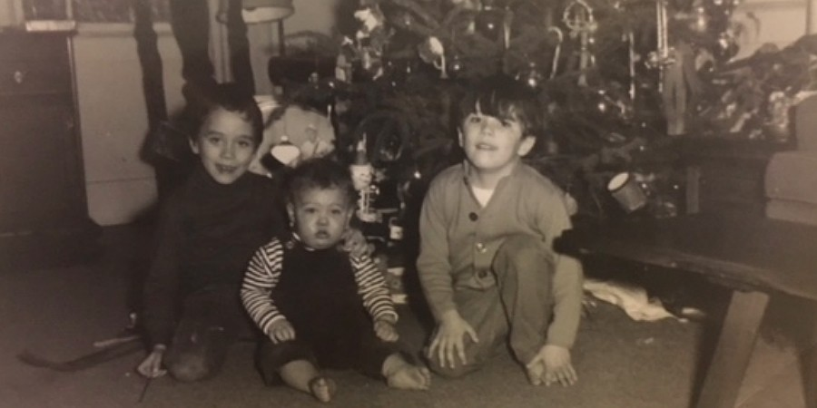 Young Tim Caulfield (right, pictured with older brother Case and baby brother Sean) hit peak Christmas gift at age five when he got a cardboard submarine from Santa.