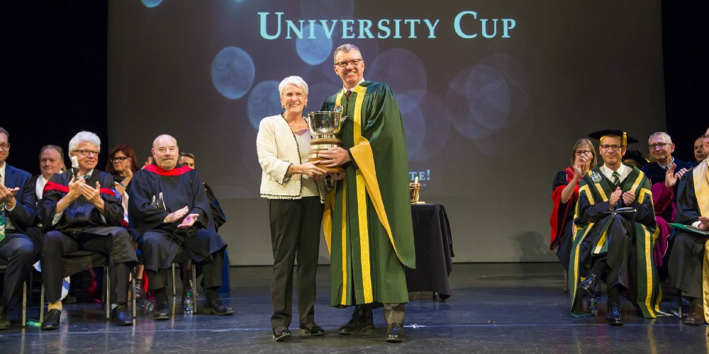 Janine Brodie (pictured here receiving the University Cup from UAlberta president David Turpin in 2017) is one of the newest members of the Order of Canada. (Photo: Office of the Registrar)