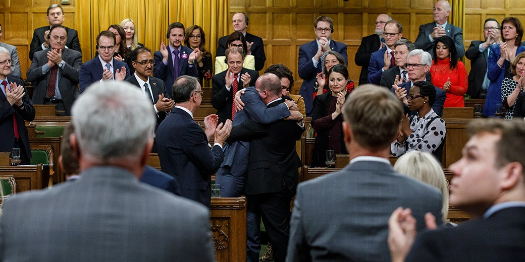 Prime Minister Justin Trudeau hugs Liberal MP Randy Boissonnault after making a formal apology to people harmed by federal legislation, policies and practices that led to the oppression of and discrimination against LGBTQ people in Canada, in the House of Commons Nov. 28, 2017. (Photo: Prime Minister of Canada)