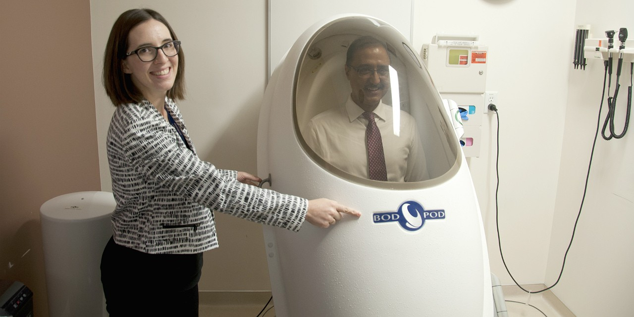 Human nutrition research co-ordinator Stephanie Ramage seals Minister Amarjeet Sohi in the university's body composition tracking system as part of a tour of the Alberta Diabetes Institute, which figured prominently in a federal government funding announcement today.