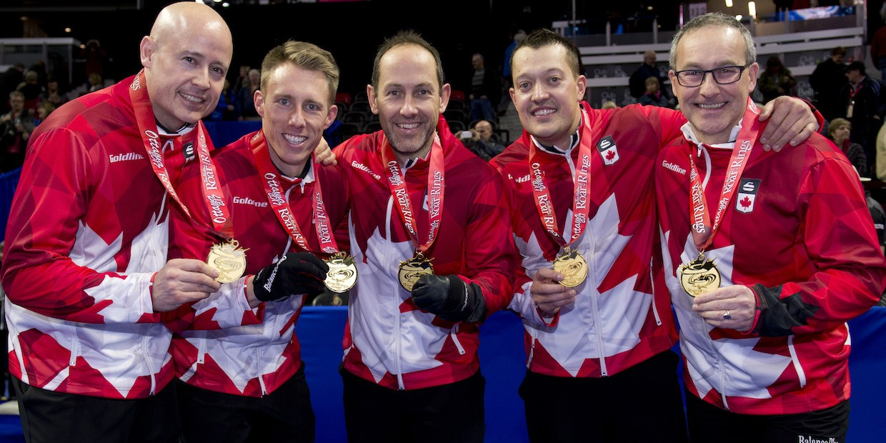 John Dunn (right) celebrates with Team Koe after their victory in the 2017 Canadian Olympic Curling Trials. Dunn is joining the team as a mental performance coach as they compete for gold in the 2018 Winter Olympics in PyeongChang, South Korea.