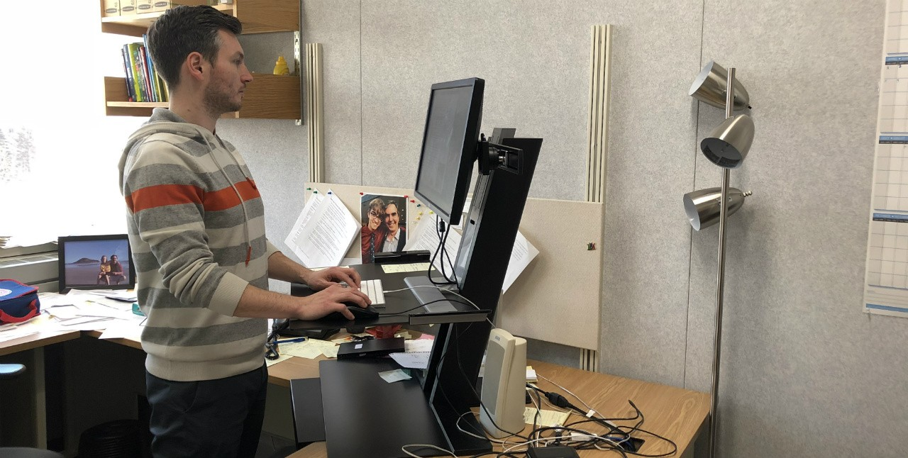 A standing desk won't make you more physically active than a sit-down desk, and good posture is especially important when standing for long periods, says a UAlberta ergonomics expert. (Photo: Tim Schneider)