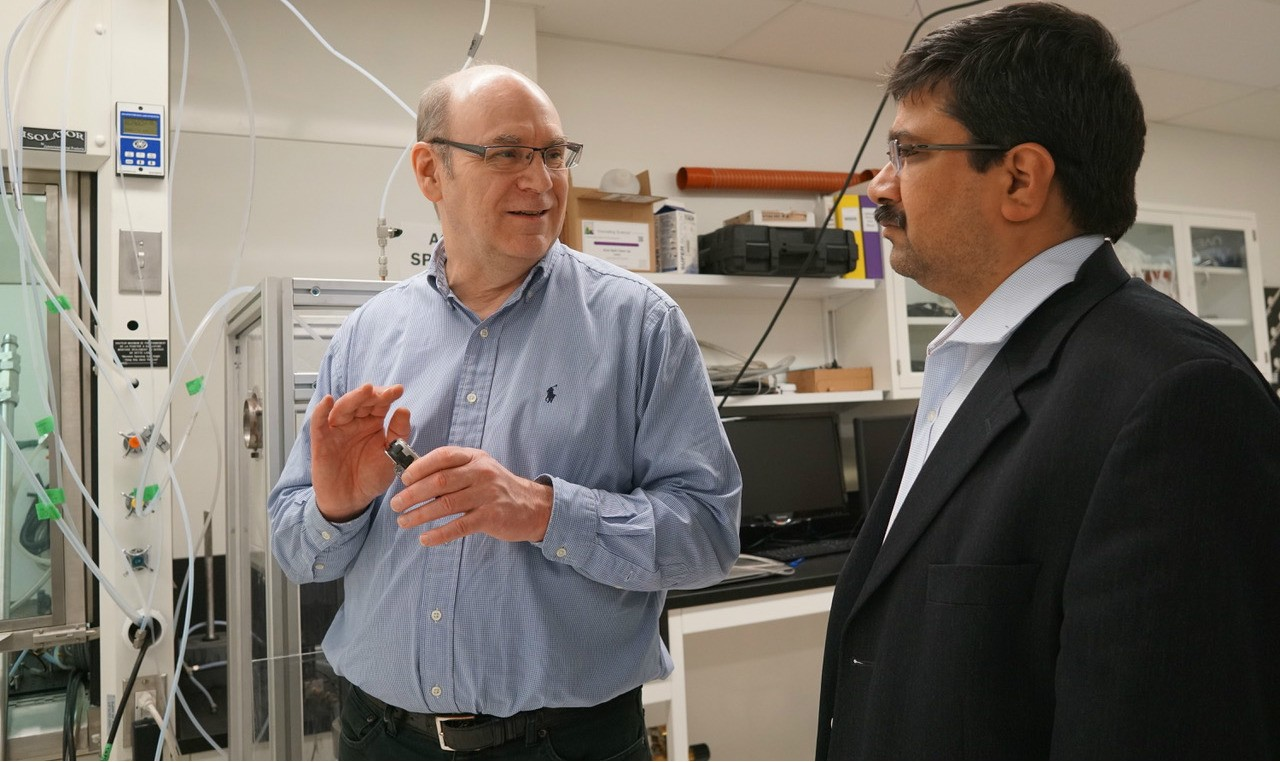 "Future Energy Systems director Larry Kostiuk in his lab with deputy director Amit Kumar. ""No single alternative energy technology is going to reliably meet the energy needs of every society around the world,"" Kostiuk says, ""so we have a lot of work to do."" (Photo: Kenneth Tam)"