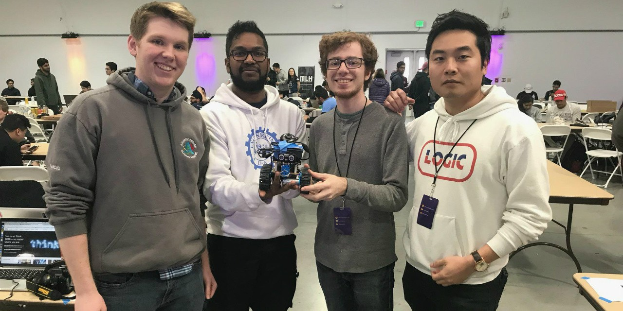 Electrical engineering student Megnath Ramesh (second left) with his team that took three top prizes at a San Francisco hackathon for programming a security robot to patrol places like malls, museums or homes and identify intruders. (Photos courtesy Megnath Ramesh)