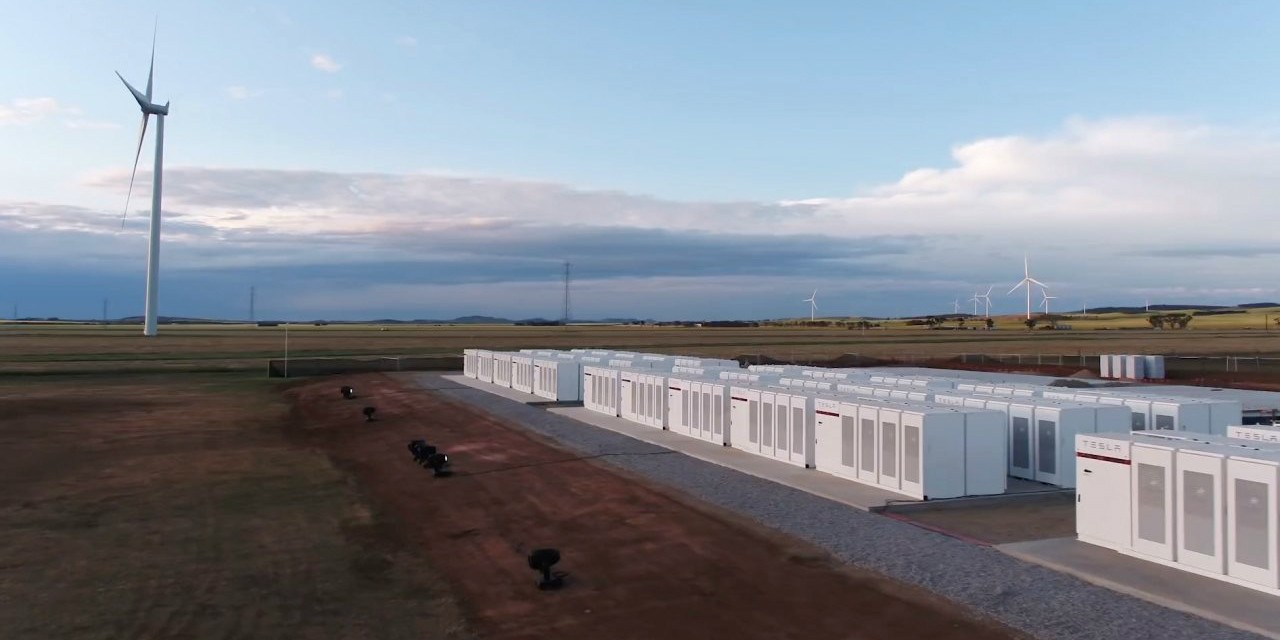 Tesla's massive 100-megawatt battery facility in South Australia stores renewable energy from wind turbines—but moving the entire world to sources like wind and solar power will require new ways to store the energy, says a UAlberta researcher. (Photo: Tesla)