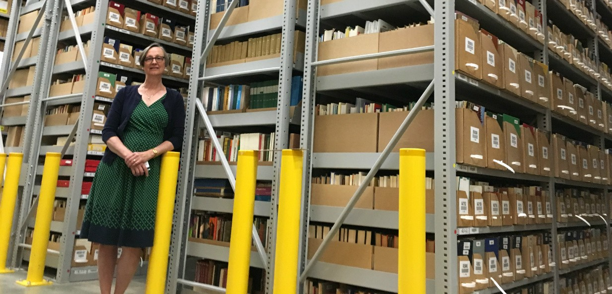 Sandra Shores shows off the high-density archival storage area at the RCRF. The vast climate-controlled space contains shelves that run from the floor to the ceiling, more than three storeys high. (Photo: Bev Betkowski)