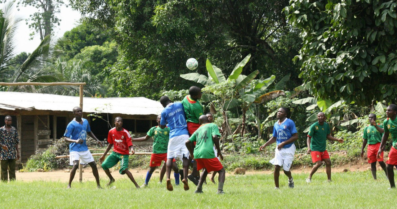 A team of young men plays soccer against national park wardens in an effort to promote conservation of primates in southwestern Cameroon. (Photo: Korup Rainforest Protection Society)