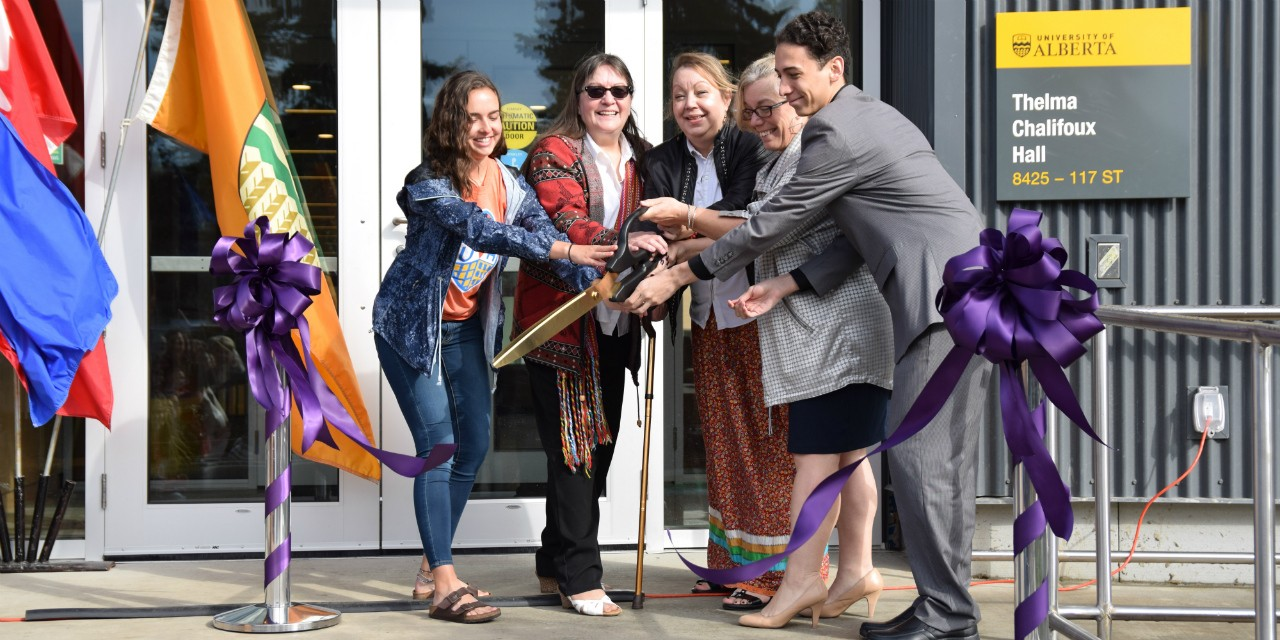 Thelma Chalifoux's daughters Debbie Coulter, Sharon Morin and Julie Handrahan (centre) cut the ribbon to officially open the new U of A residence named in Chalifoux's honour, with help from senior residence assistant Laura Dow (left) and Joaquin Calderon, VP for Thelma Chalifoux Hall for the Lister Hall Students' Association. (Photo: Eric Athanas)