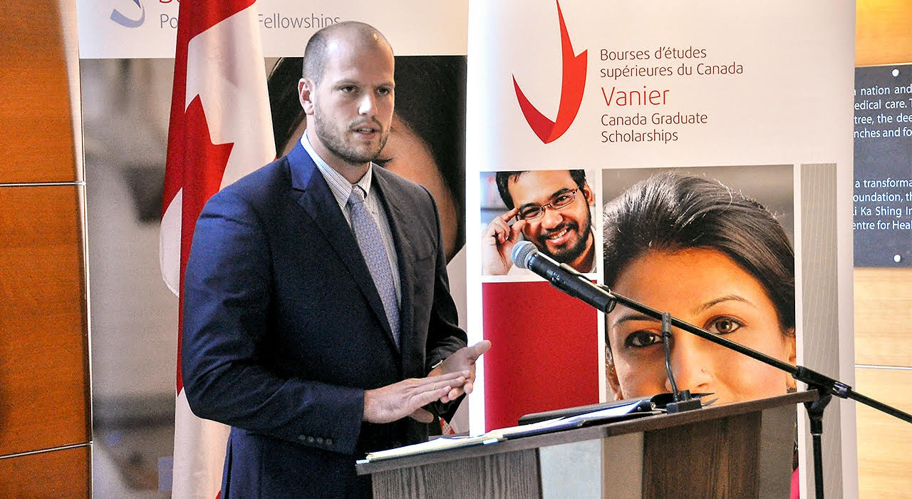 Criminology graduate student William Schultz relates his experiences as a former corrections officer at an event today announcing 10 U of A recipients of the national Vanier Canada Graduate Scholarships, along with two winners of Banting Postdoctoral Fellowships. (Photo: Michael Brown)
