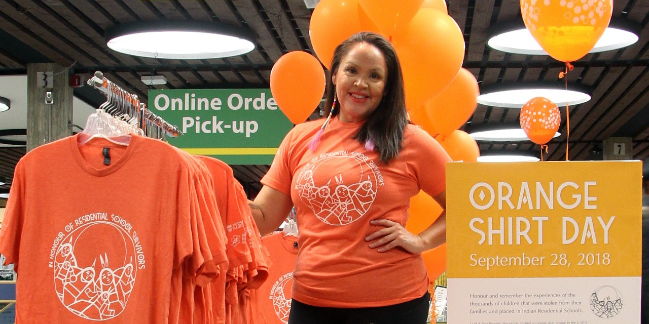 Shana Dion, assistant dean, First Nations, Métis and Inuit students, wears the orange shirt available from the U of A bookstore to help the university community commemorate Orange Shirt Day this Friday. Proceeds from the shirt sales will go toward cultural programming for Indigenous students at the U of A. (Photo: Sarah Coffin)