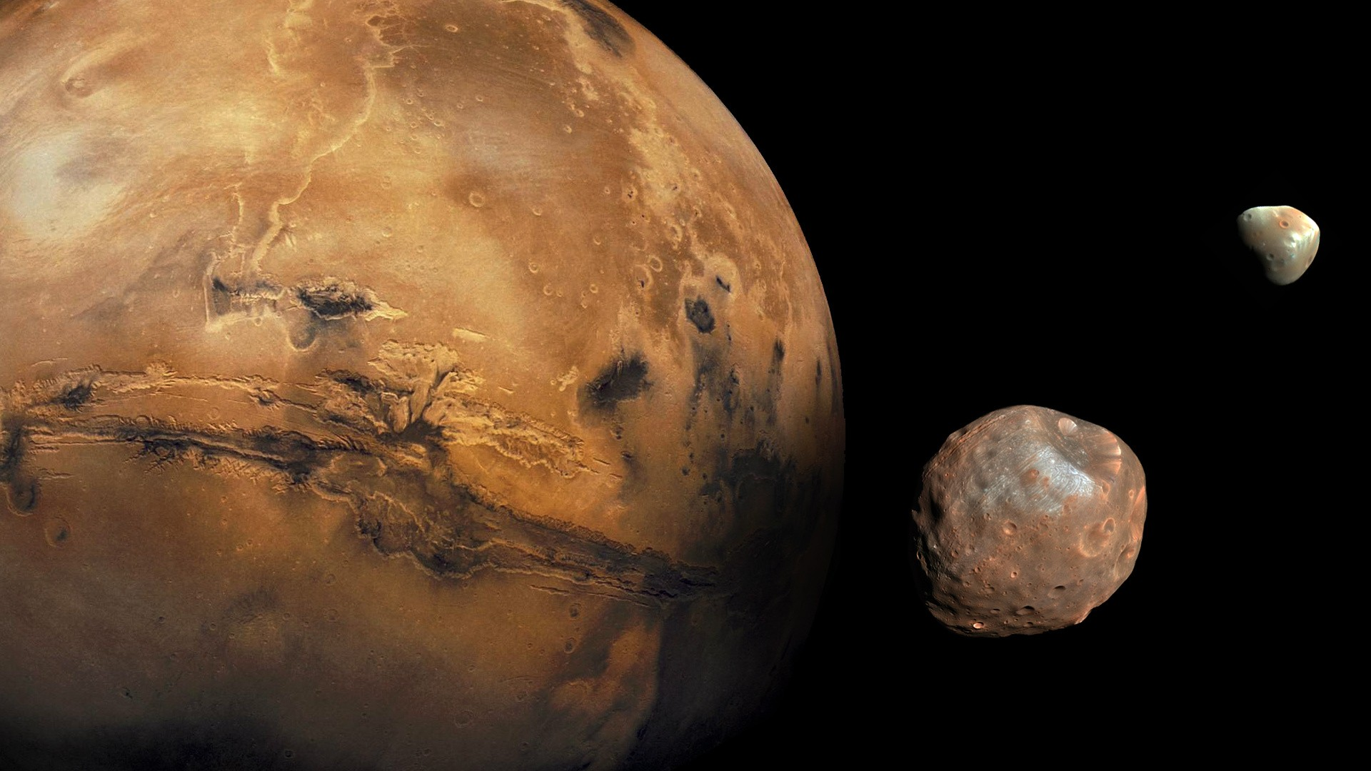 Mars' two moons, Phobos and Deimos, were likely formed from chunks blasted from the red planet rather than from asteroids trapped in the planet's gravitational pull, a new study suggests. (Photo: NASA/JPL-Caltech/Malin Space Science Systems/Texas A&M Univ.)