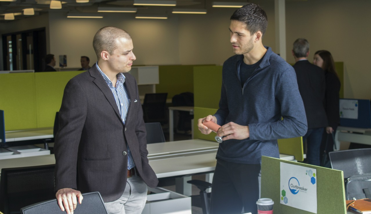 Brayden Whitlock (left), a PhD candidate at the U of A and research director of Outbreaker Solutions, speaks with the company's operations and finance director, Matt Hodgson, at today's grand opening of the TEC Centre Labs. The $2.3-million space is home to two business accelerators aimed at speeding health innovations globally and locally. (Photo: Ross Neitz)