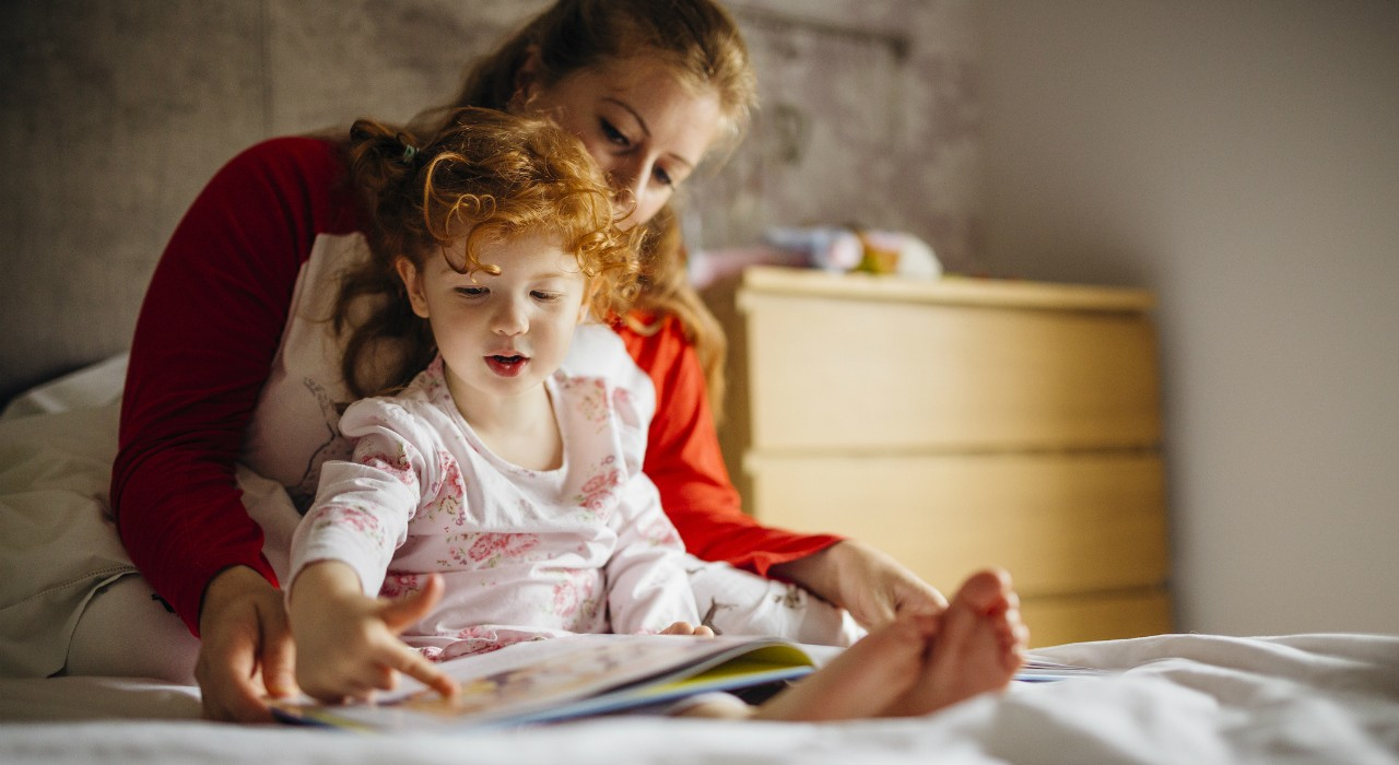 Sticking to a regular sleep schedule, reducing screen time before bedtime and getting ready for bed with quiet activities like reading can help both children and parents adjust to the time change. (Photo: Getty Images)
