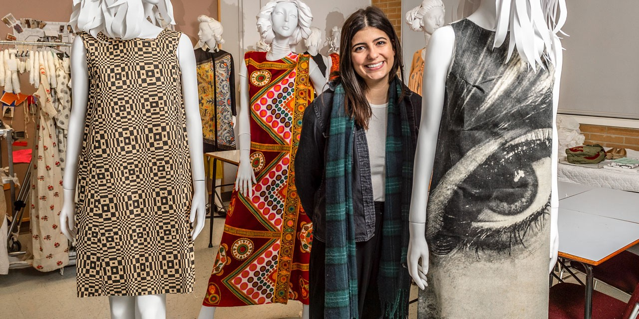 "U of A student Gabriella Sequeira with the disposable paper ""eye"" dress she researched for the Fashion in Print exhibit. ""It's the poster child for 1960s consumerism,"" she says of the dress, which sold for $2.50 in 1968. (Photo: Richard Siemens)"
