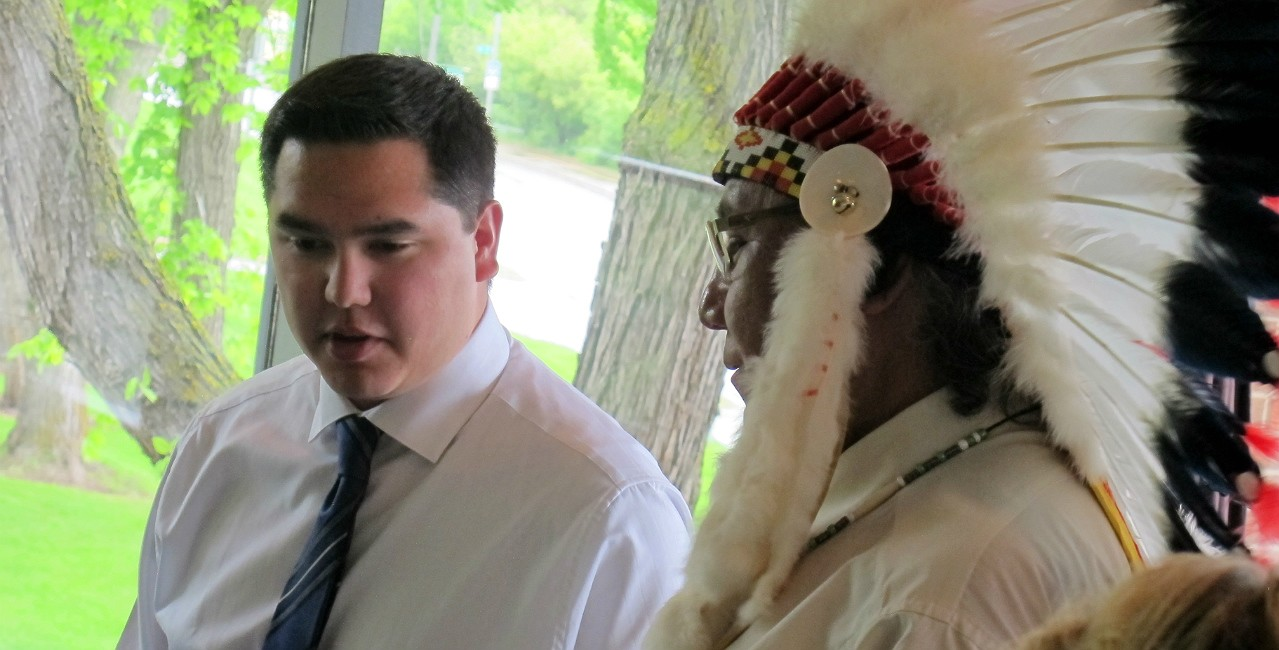 Shey Eagle Bear (left) speaks with Elder Leonard Saddleback during a ceremony recognizing Indigenous medical school graduates in 2014. A new admission policy will create more opportunities for Indigenous students like Eagle Bear, who now has a family practice in the Kainai Nation (Blood Tribe) community in southern Alberta. (Photo: Faculty of Medicine & Dentistry)