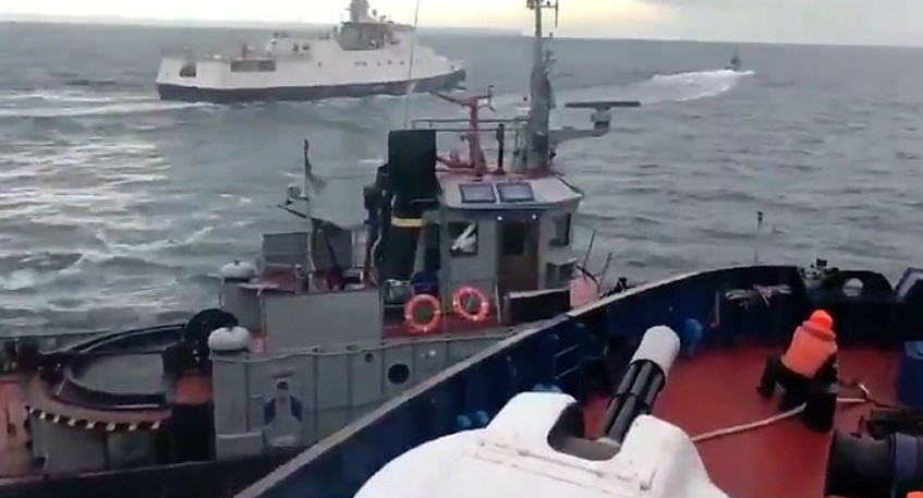 In this image taken from video tweeted on Nov. 25 by Ukrainian Interior Minister Arsen Avakov, a ship appears to ram the side of a Ukrainian tugboat in the contested Kerch Strait. Russia claimed three Ukrainian warships were seized after entering Russian waters illegally.