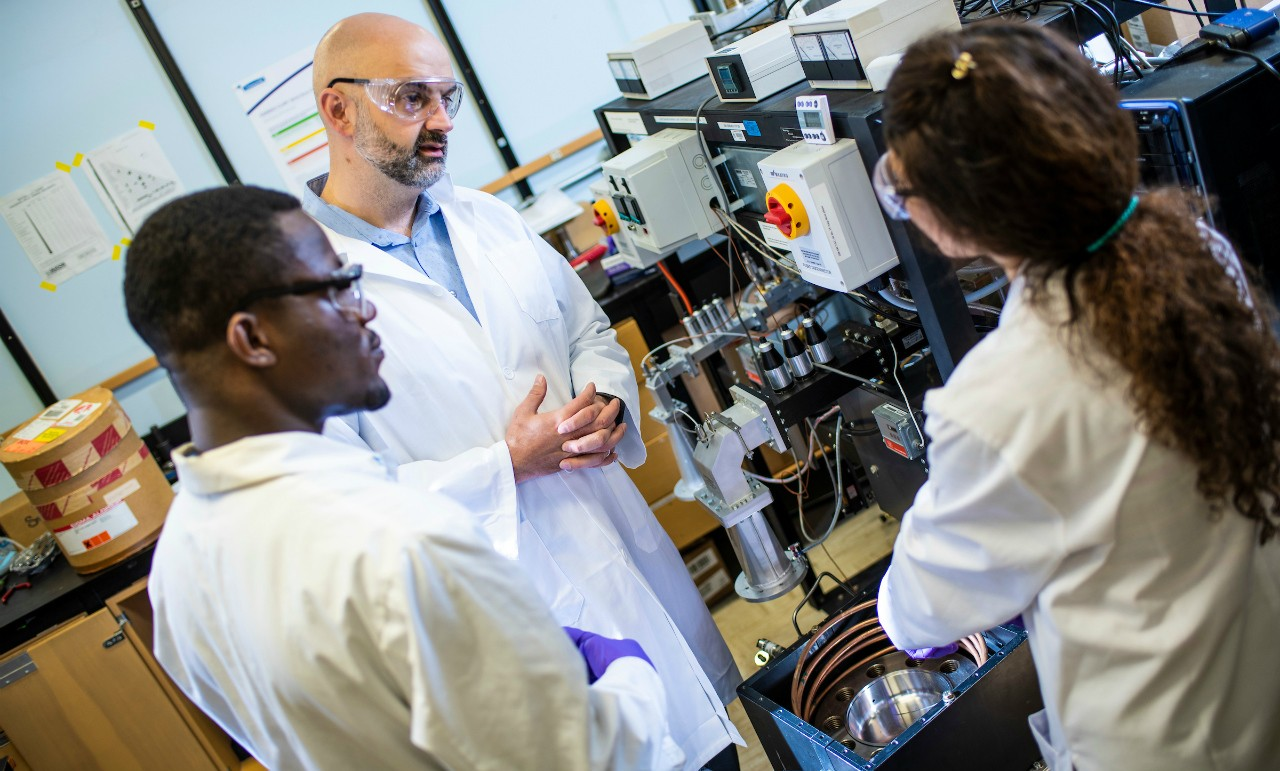 Bioresource scientist David Bressler (second left) with graduate student Samuel Koranteng (left) and post-doctoral researcher Maryam Hawk in Bressler's lab at the U of A. Bressler's spinoff company, Forge Hydrocarbons, is set to open a $25-million, commercial-scale production plant late next year with help from a US$4-million investment by Lockheed Martin. (Photo: John Ulan)
