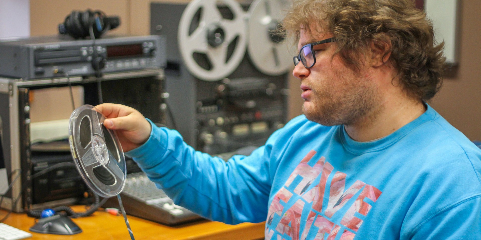 Tom Merklinger, a master's student in music composition at the U of A, is one of several grad students helping to transfer thousands of Indigenous recordings dating back to the 1960s as part of the Digitizing the Ancestors project. (Photo: Sound Studies Institute)