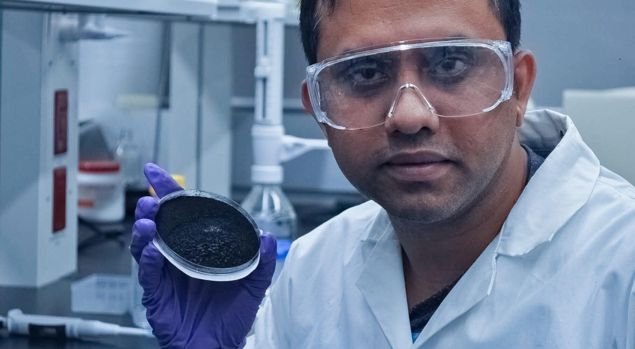 Samrat Alam holds a sample of biochar. Alam and U of A geochemist Daniel Alessi found that the inexpensive charcoal can be tailored for specific uses like water treatment or soil remediation by controlling the temperature and organic material used to produce it. (Photo courtesy of Samrat Alam)