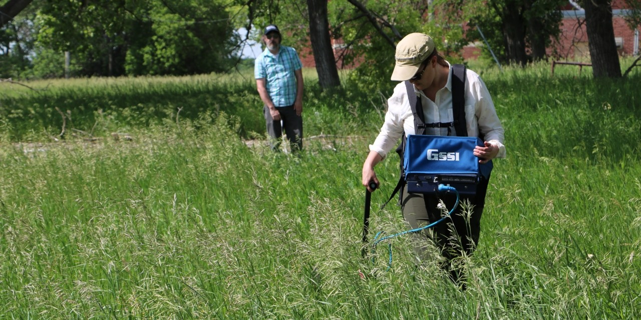 Archeologists Kisha Supernant (right) and Terence Clark use ground-penetrating radar to search for unmarked graves near the former Muskowekwan Residential School in Saskatchewan. (Photo: Liam Wadsworth)