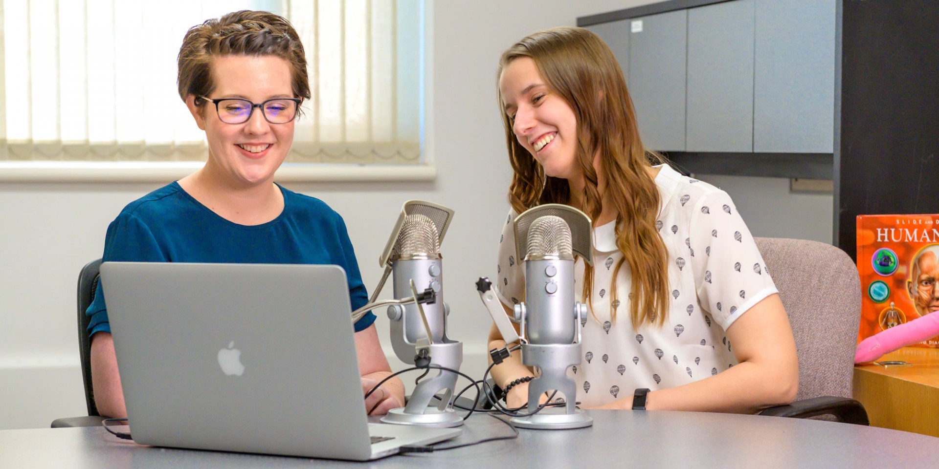 Digital education program assistant Jenni Marshall (left) and medical student Natalie Marsden have produced 11 Surgery ABCs podcasts so far, covering topics aimed at teaching kids about their bodies and getting them excited about health careers. (Photo: Richard Siemens)