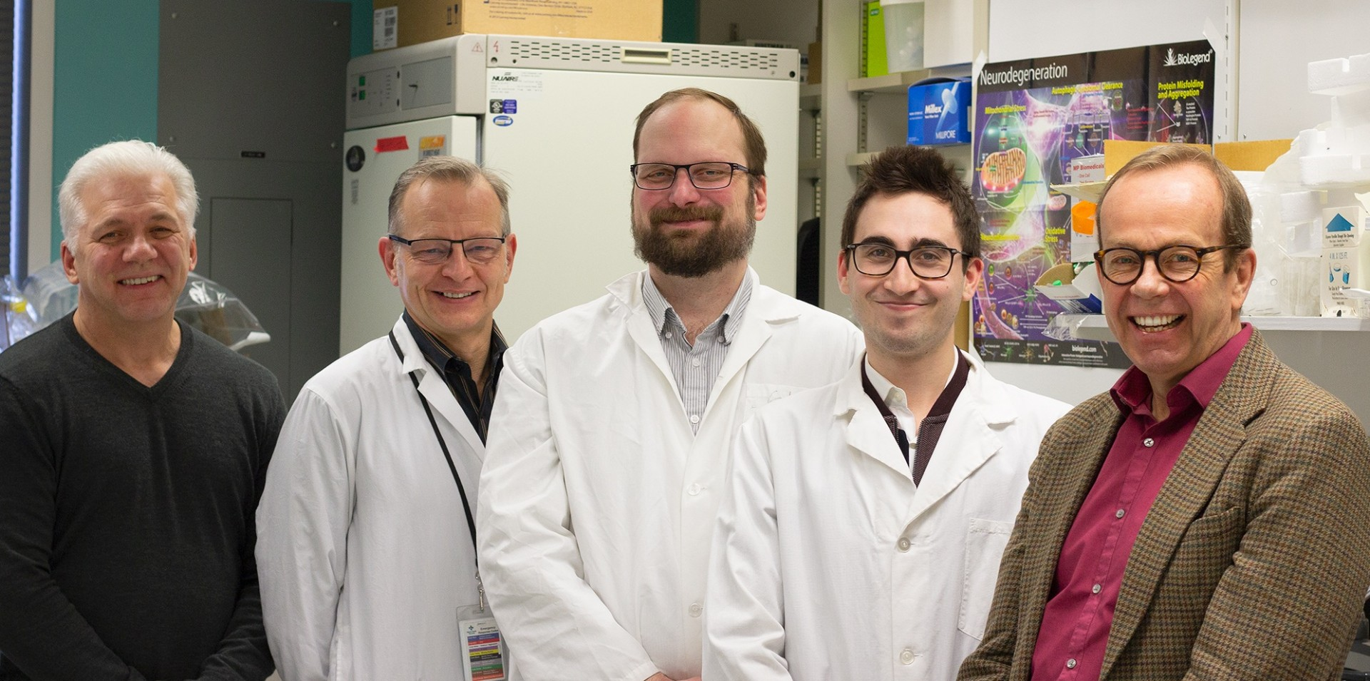 (From left) Medical researchers Tom Hobman, Frank van Landeghem, William Branton, Matthew Doan and Christopher Power were part of a U of A team that discovered a seemingly harmless virus is actually a cause of encephalitis. (Photo: Jordan Carson)