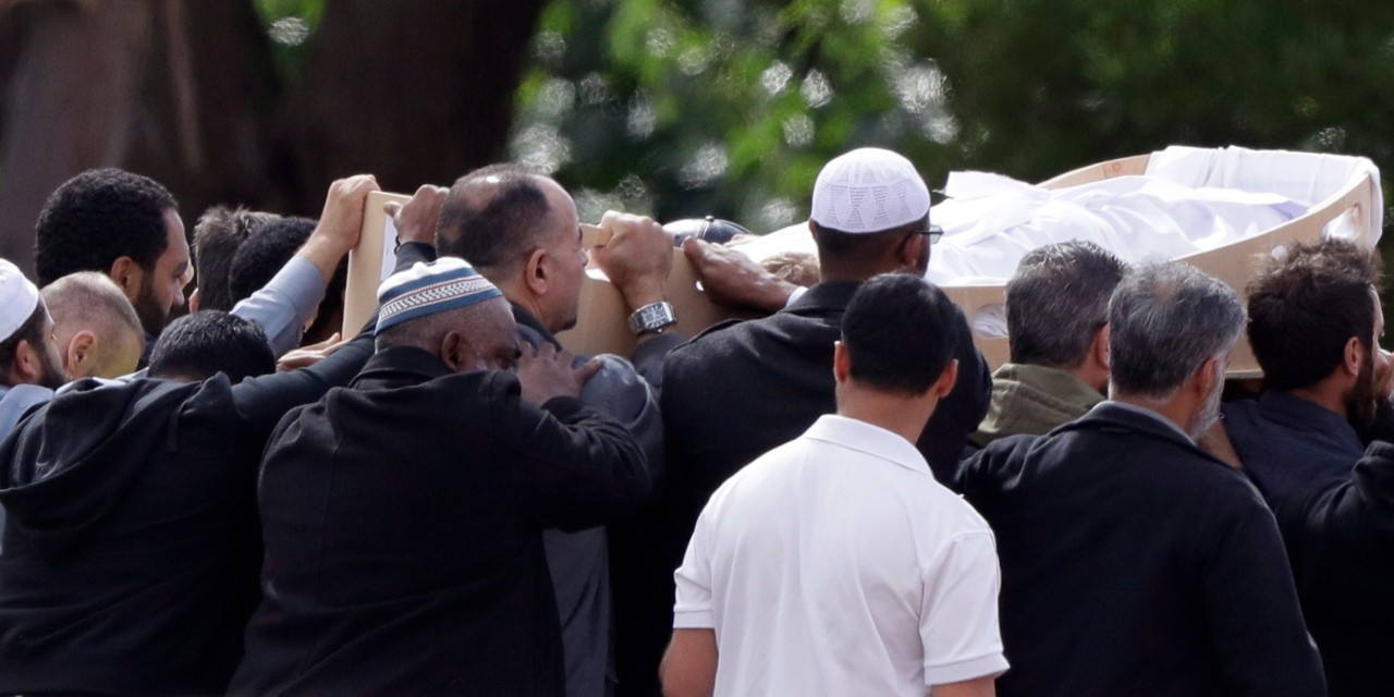 Mourners carry the body of a victim of the New Zealand mosque shootings for a burial in Christchurch on March 20, 2019. (Photo: AP/Mark Baker)