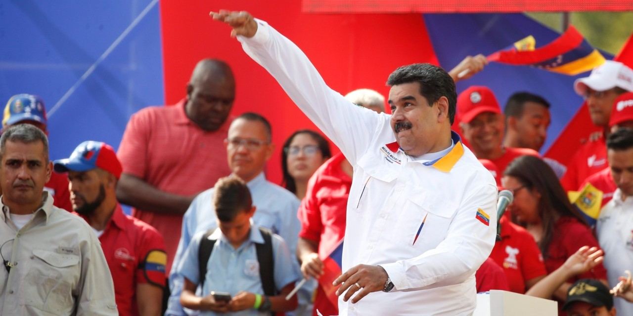 Venezuelan President Nicolás Maduro throws his handkerchief into a crowd of supporters at an anti-imperialist rally for peace in Caracas in March 2019. (Photo: AP/Natacha Pisarenko)