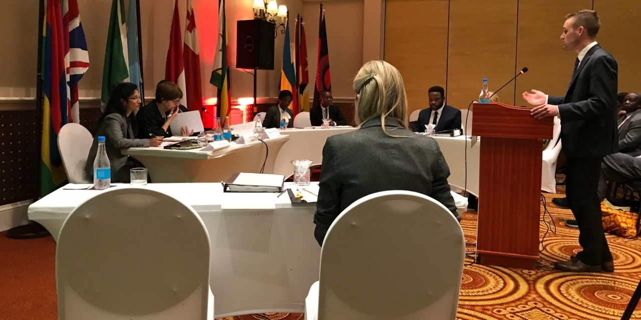 U of A law student Dylan Hanwell makes an argument in the final round of the Commonwealth Moot in Livingstone, Zambia, as teammate Leah Strand (foreground) looks on. The U of A team won the international competition for the first time and is only the fourth Canadian team to win since 1983. (Photo courtesy of Peter Sankoff) .