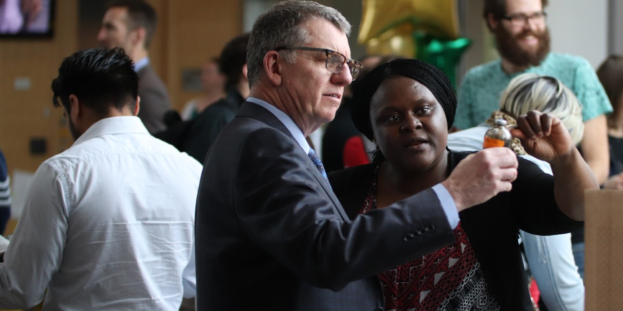 U of A president David Turpin speaks with post-doctoral researcher Gloria Okpala, whose research involves using bacteria to help separate contaminants in oilsands tailings water, at the launch of the Energy Systems signature area. (Photo: Kenneth Tam)