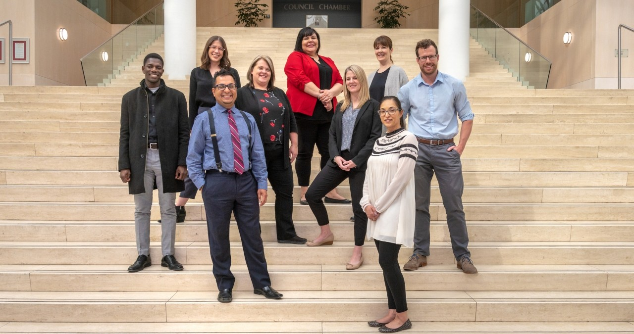 The City of Edmonton's Talent Outreach and Work Experience Programs team stand in the atrium of City Hall, where they will receive a U of A award today for their commitment to providing work experience and career opportunities for post-secondary students. (Photo: Richard Siemens)