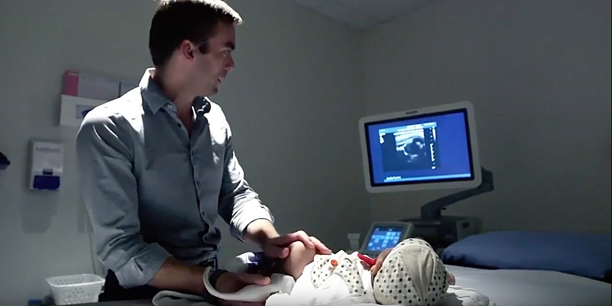 U of A radiologist and Medo.ai co-founder Jacob Jaremko performs an ultrasound scan on a baby to diagnose hip dysplasia. The U of A spinoff company is developing an app that would allow expert analysis of medical ultrasound images with minimal training—a boon for rural and remote areas with limited access to radiology services. (Image: Medo.ai)