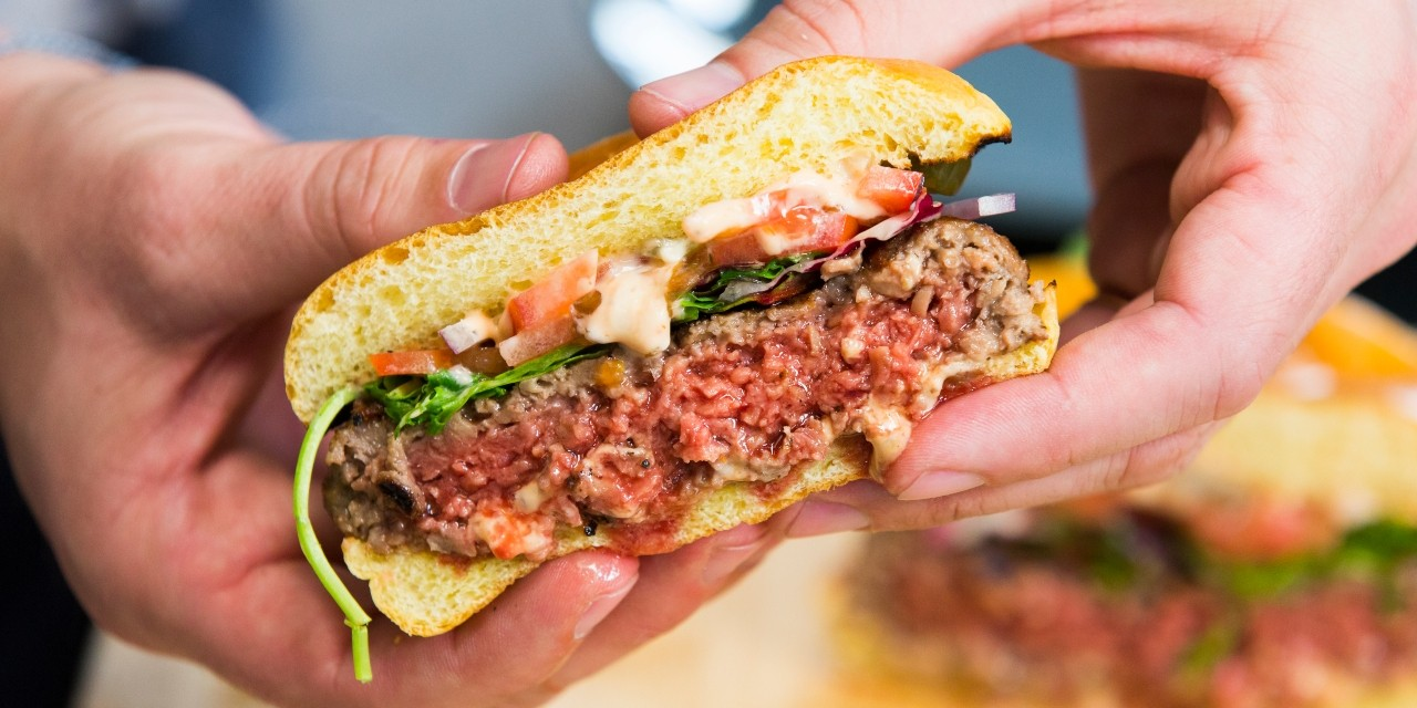 New plant-based burgers may look and taste a lot more like beef, but will consumers bite? New research suggests it could take a long time to change their behaviour. (Photo: Impossible Burger)