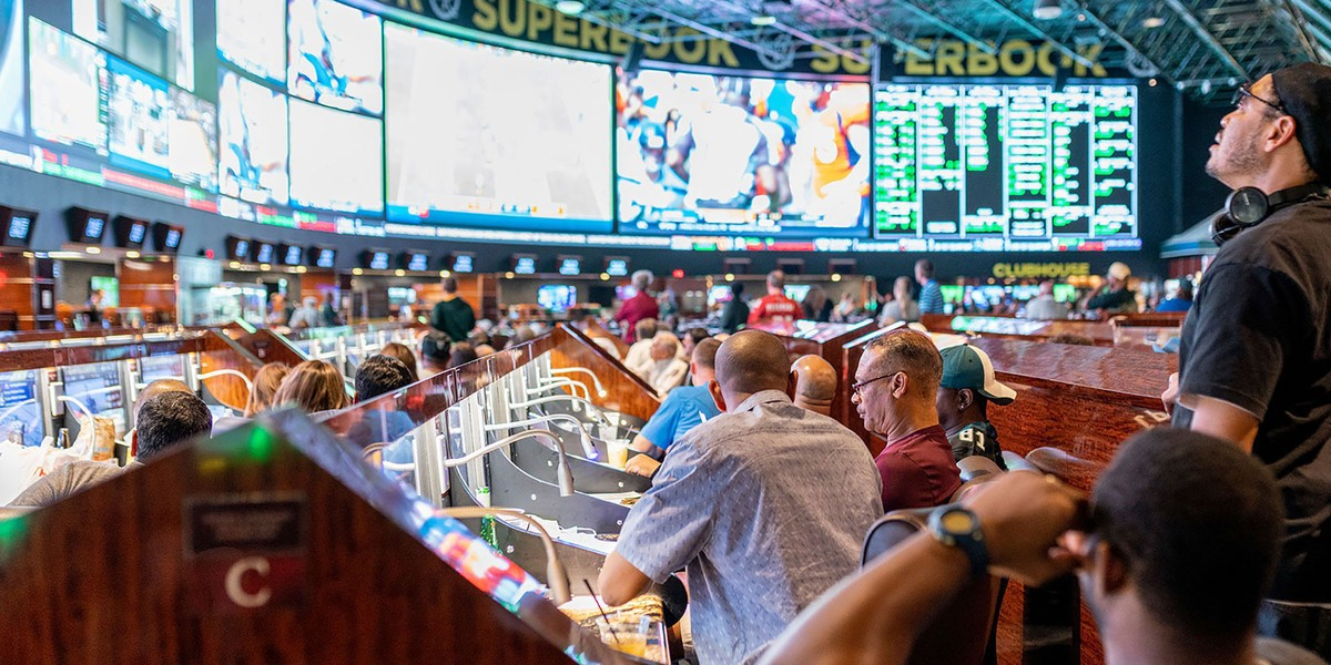 Bettors watch games unfold on big screens at a sports book in Las Vegas. Bookmakers capitalize on fans' emotional attachment to their favourite teams to turn a profit from sports betting no matter who wins, according to a new study by a U of A sports management expert. (Photo: Westgate Resorts)