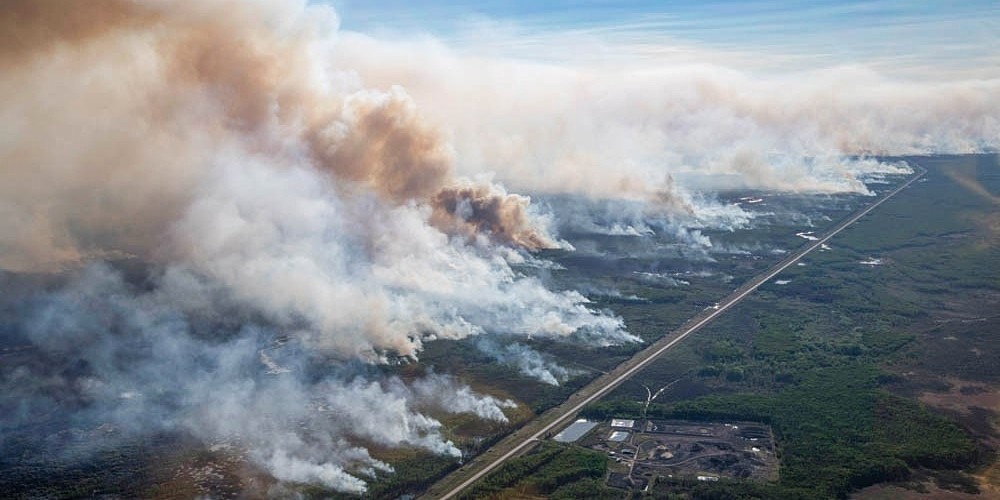 The Chuckegg Creek wildfire that raged near High Level covered much of Alberta with smoke in May of this year and has since burned 350,000 hectares of forest. A U of A wildfire scientist is working on an AI-based tool that analyzes weather and forestry data to predict the likelihood of fires breaking out, and possibly help firefighters prevent them from burning out of control. (Photo: Chris Schwarz/Government of Alberta)