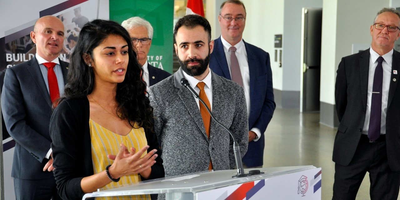 U of A master's student Monica Shandal and PhD candidate Fahed Elian talk about their international experiences during the announcement today of nearly $148 million in federal funding for post-secondary education abroad. (Photo: Michael Brown)