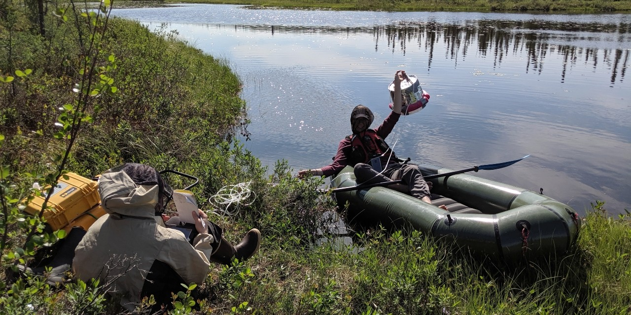 Kenzie Kuhn (right) and research assistant Maya Frederickson collect samples from a pond in Wrigley, N.W.T., for Kuhn's PhD research on methane emissions from thawing permafrost. (Photo: Supplied)