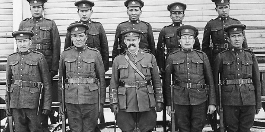 Mike Mountain Horse (bottom row, right) poses with fellow Blood Tribe recruits in the 191st Battalion of the Canadian Expeditionary Force at Fort Macleod, Alberta, in 1916. In speaking engagements, Mountain Horse mentioned that he enlisted in the First World War to avenge the death of his brother Albert. (Photo: Glenbow Archives, NA-2164-1)