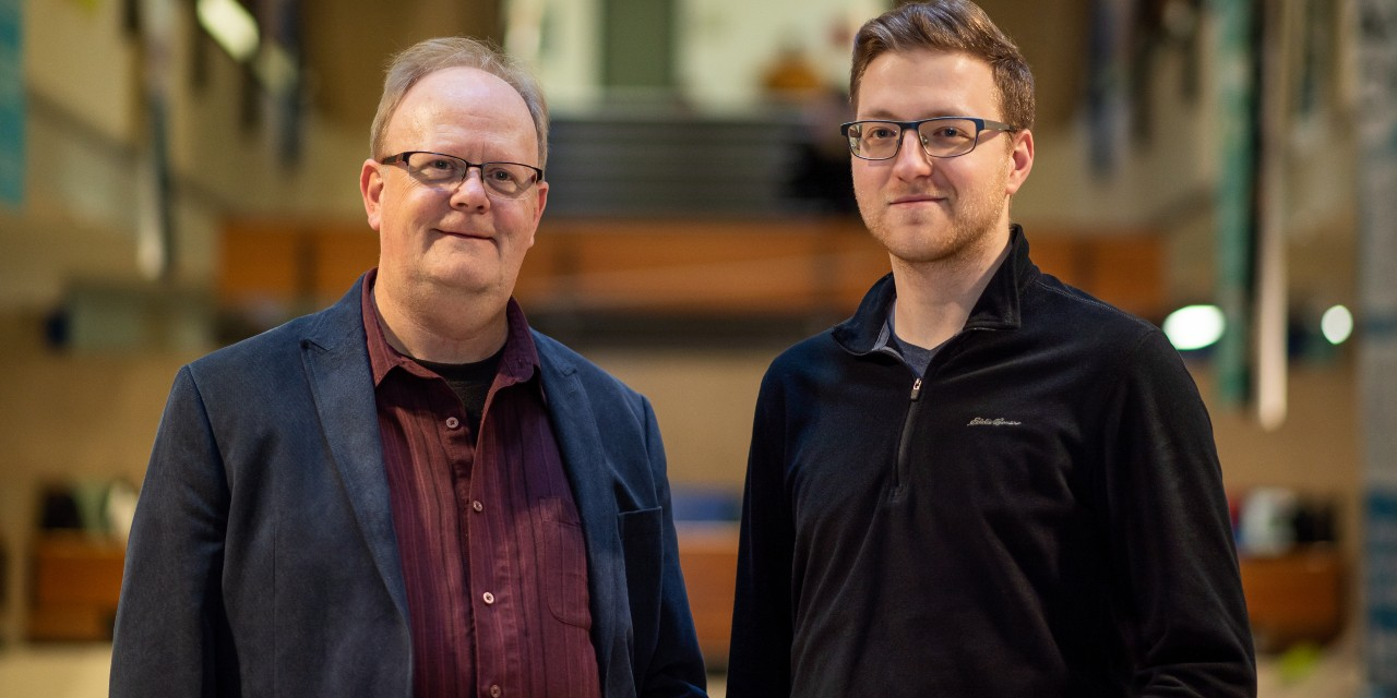 Mathematician Thomas Hillen (left) and PhD student Adam Rhodes analyzed hundreds of studies on different cancers to develop a new model explaining how the immune system may contribute to the spread of the disease in the body. (Photo: Dawn Graves)