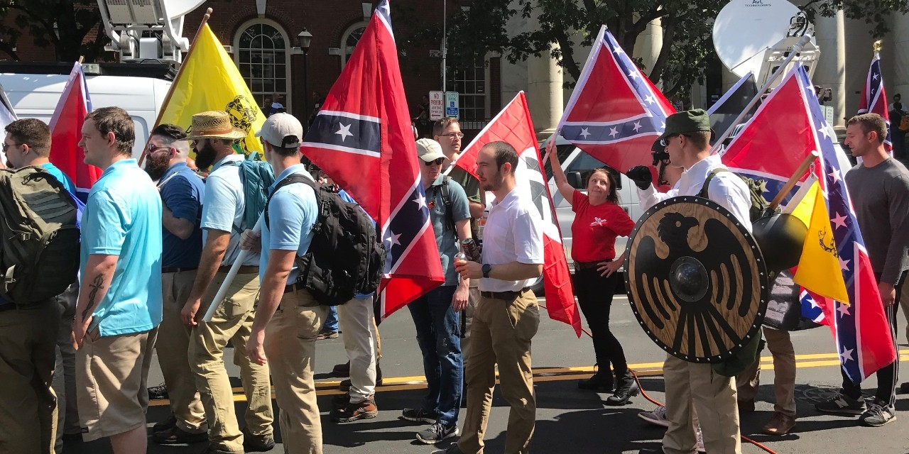 "Marchers at the Charlottesville ""Unite the Right"" rally in 2017 misused a symbol of a black eagle in a round shield—a symbol associated with a saint of African descent in the early Middle Ages—to promote white supremacist views. (Photo: Anthony Cridder via Flickr, CC BY 2.0)"