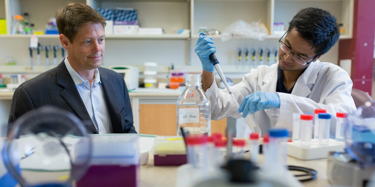 John Lewis (left), CEO of Entos Pharmaceuticals and oncology professor at the U of A, says the company is working on a DNA-based vaccine against COVID-19 that would be easier to mass-produce than traditional vaccines and would work without needing an infectious agent. (Photo: Faculty of Medicine & Dentistry)
