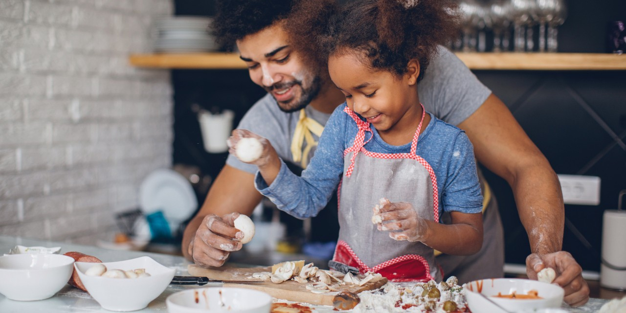 Cooking with the kids is a good way to have fun and help them keep learning new things while you're all at home. (Photo: Getty Images)