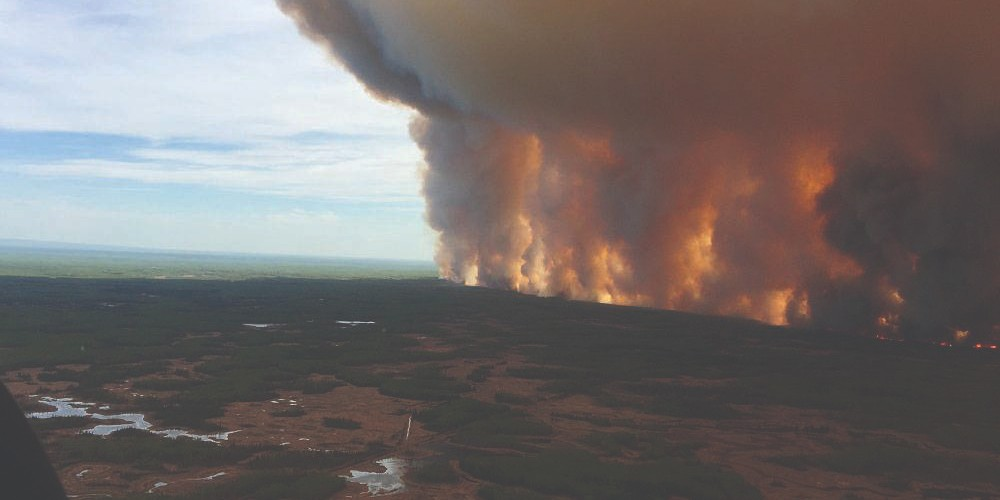 Wildfires like the Chuckegg Creek fire that forced the evacuation of High Level last year will be less likely with public health measures against COVID-19 keeping people at home this spring, says a U of A expert. (Photo: Government of Alberta)