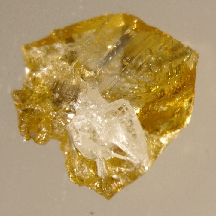 Yellow diamonds, some with colourless cores like the one pictured here, are of interest to both geologists and the gemstone industry. (Photo courtesy of Mei Yan Lai)