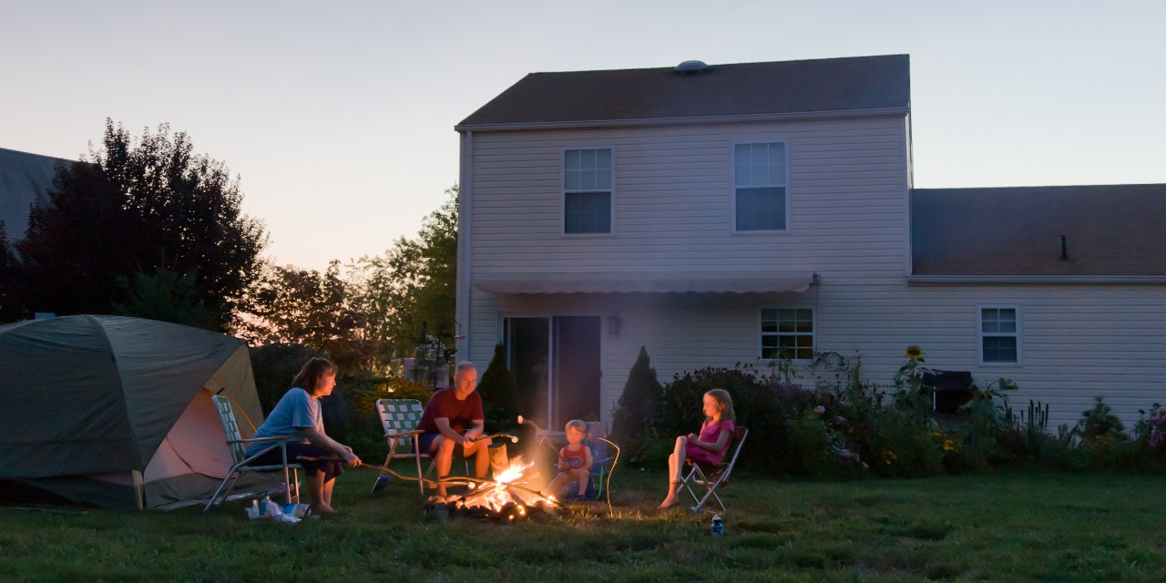 Simple experiences like backyard campfires or trips to local parks can help families enjoy some much-needed downtime without feeling like they're missing out on summer vacation, say U of A experts. (Photo: Getty Images)