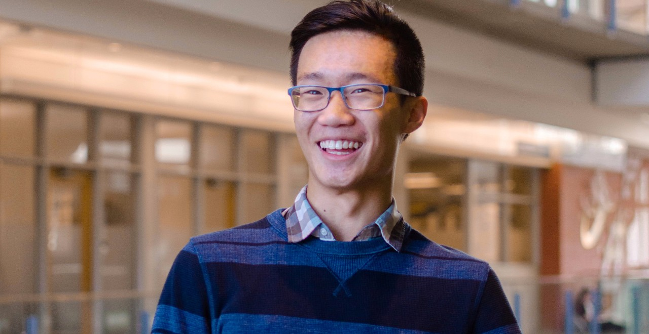 U of A student Eddie Guo teamed up with two friends from the University of Calgary to create an online tool that shows projections of COVID-19 cases and deaths based on four key demographic indicators. (Photo: Jasmine Nguyen)