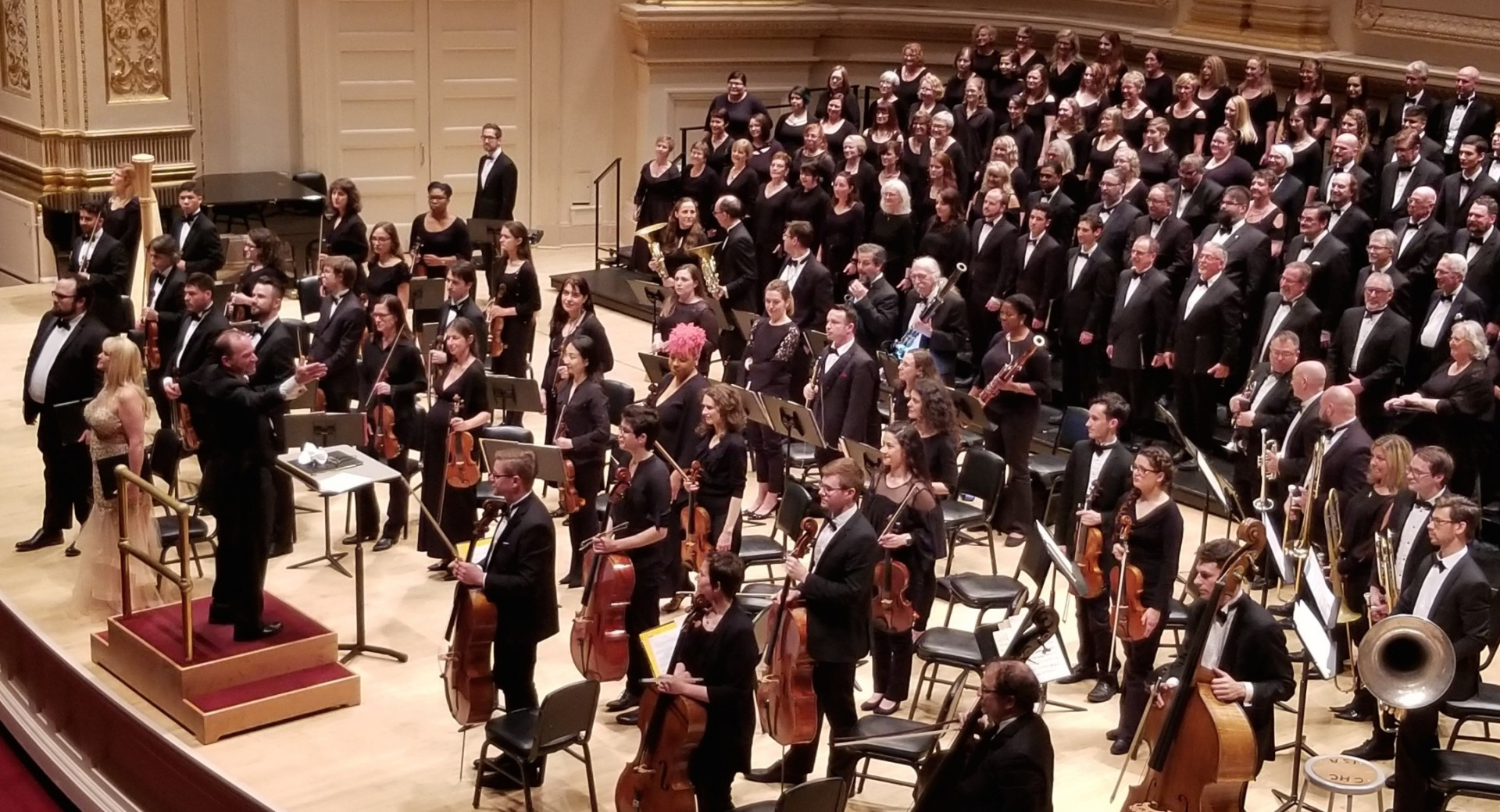 "Laurier Fagnan conducts four Canadian choirs and the New England Symphony in a performance of Dan Forrest's ""Requiem for the Living"" at Carnegie Hall on May 19, 2018. Fagnan is leading new research into whether COVID-19 can be spread by singing. (Photo: Supplied)"