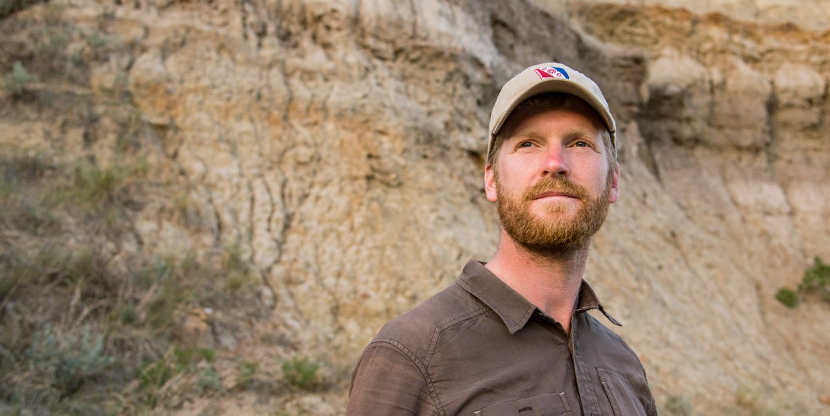 Aaron Van der Reest, seen here on the bank of the Red Deer River in Dinosaur Provincial Park, says there isn't a day in the field that goes by that he doesn't think of his mother. (Photo by Richard Siemens)